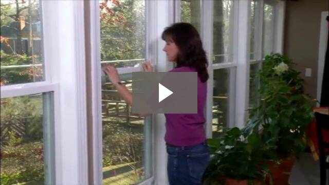 Video play button - woman opening a window