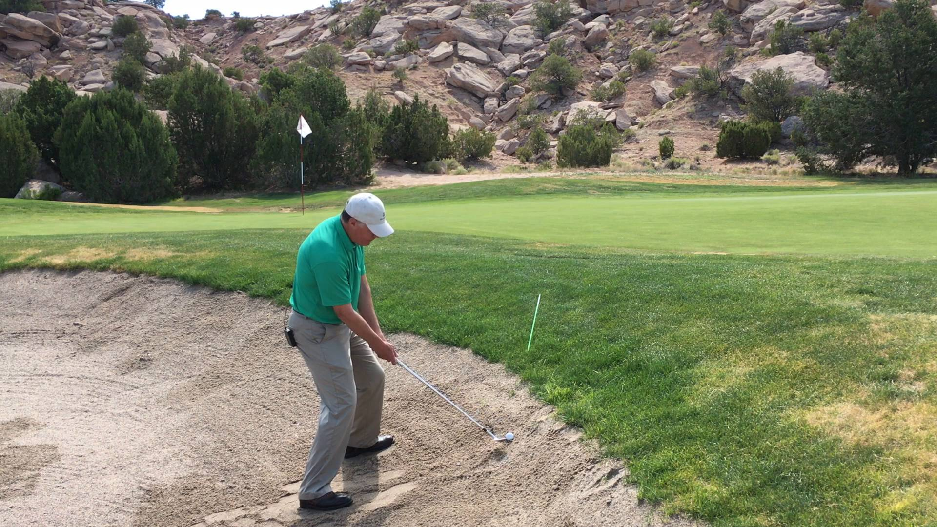Escape the Bunker from a Side Hill, Ball above Your Feet Lie