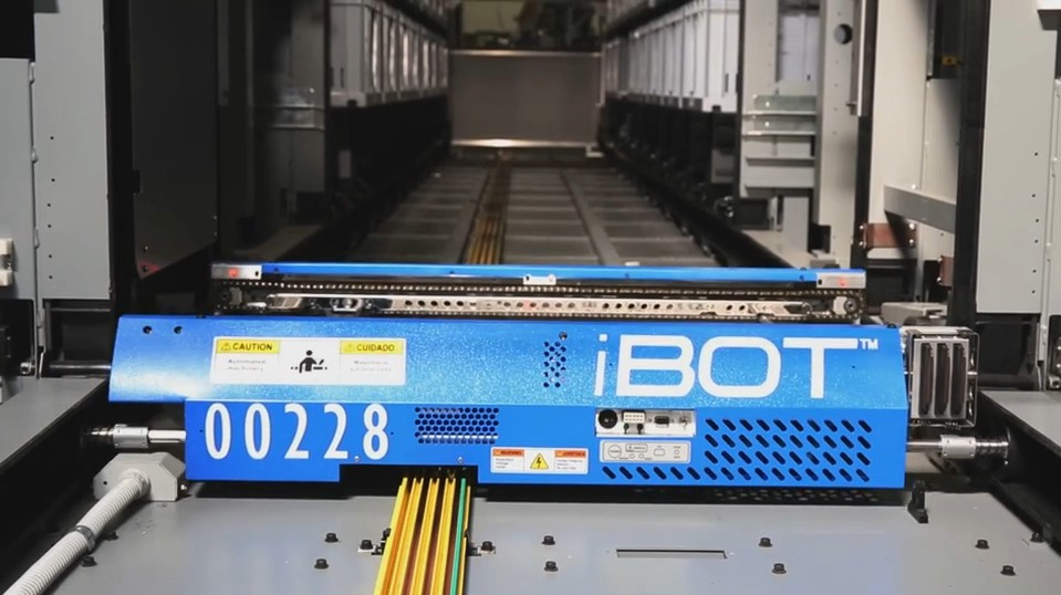 "iBOTs are intelligent wireless delivery vehicles that have 100% access to the inventory in their storage aisle and are powered by energy efficient onboard ultracapacitors that recharge ""on the fly"""