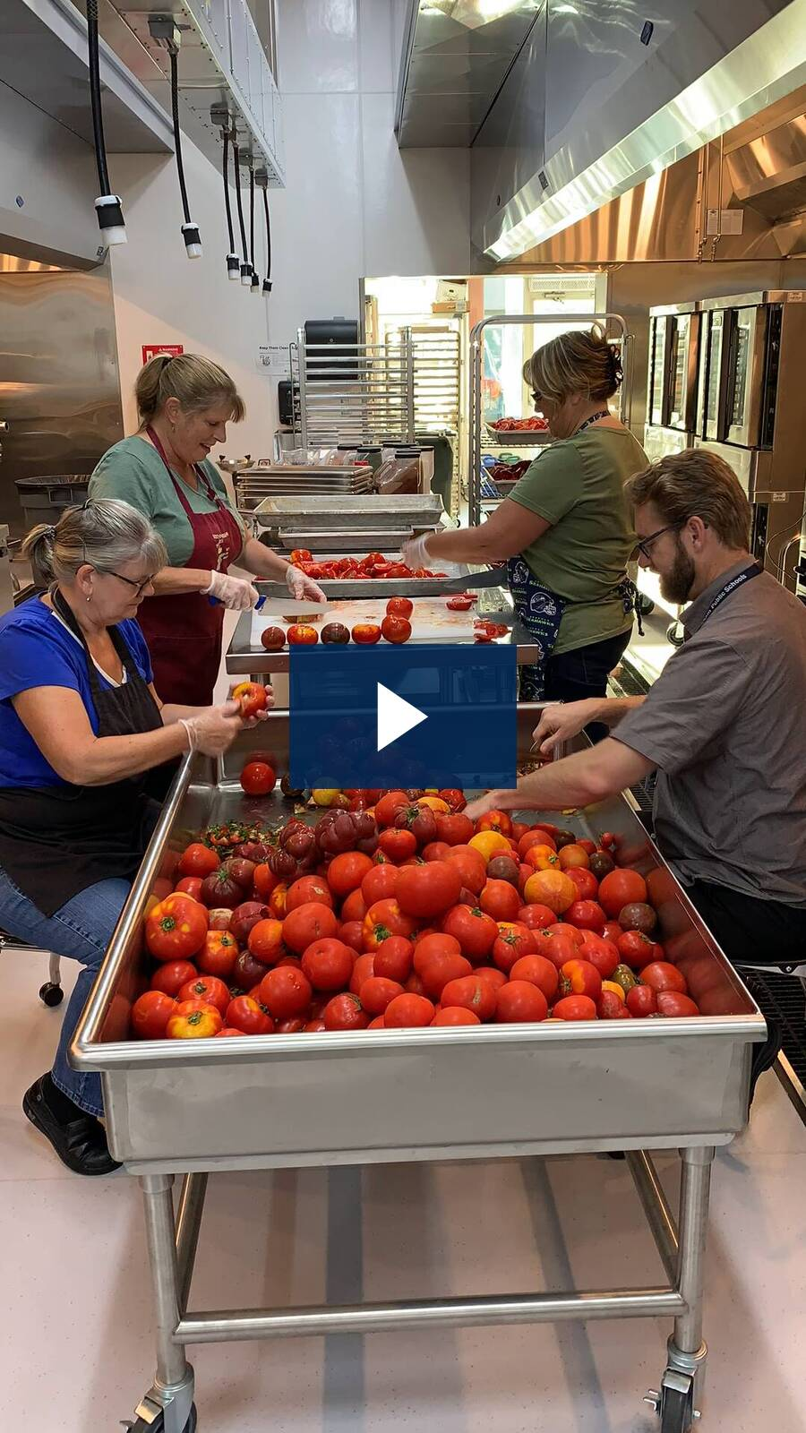 Two tons of tomatoes get processed!