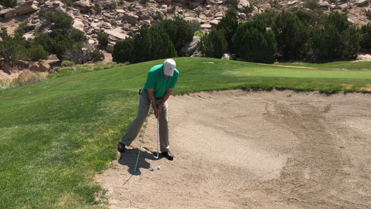 Playing from A Severe Downhill Lie in the Sand